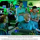 On the set of AVATAR, writer-director James Cameron (front, center) reviews a scene with actors (from left) Sigourney Weaver, Joel David Moore and Sam Worthington. Photo credit: Mark Fellman