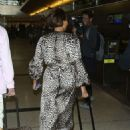 Melanie Brown – Arriving at Lax Airport In Los Angeles - 454 x 681