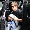 Zac Efron arrives at his hotel in New York City wearing an all denim outfit