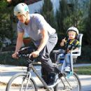 Josh Duhamel is spotted enjoying a bicycle ride with his growing son Axl on January 8, 2016 in Brentwood - 446 x 600