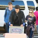 Emma Roberts and Garrett Hedlund – Arrives at LAX International Airport in LA