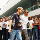 Sebastian Vettel (L) of Germany and Infiniti Red Bull Racing and Lewis Hamilton (R) of Great Britain and Mercedes GP attend the drivers parade before the Indian Formula One Grand Prix at Buddh International Circuit on October 27, 2013 in Noida, India - 406 x 594