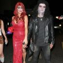 Slash and Perla as zombies for a Halloween party in Los Angeles