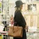 Rosie Huntington-Whiteley was seen holding her pregnant belly while shopping at ABC Carpet & Home store in New York City, New York on April 6, 2017 - 401 x 600