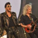 Adam Lambert performs with Brian May of Queen at 02 Arena on January 17, 2015 in London, England