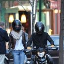 Orlando Bloom and Miranda Kerr leave a West Village clothing store only to find that Bloom's Ducati motorcycle is stalled. After getting help from some friendly photographers, Bloom and Kerr ride off together.April 2 2010