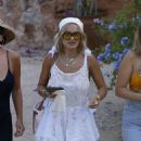 Rita Ora – In a white dress out for dinner in Ibiza