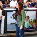 Megan Fox plays a reporter on the set of 'Teenage Mutant Ninja Turtles' in New York City's Times Square on July 22, 2013