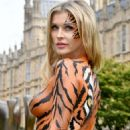 Joanna Krupa – Bodypaint while protesting outside Westminster in London - 454 x 681