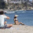 Jenna Dewan in a navy blue bikini with her boyfriend Steve Kazee