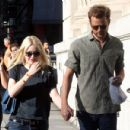 A smitten looking Dakota Fanning and her boyfriend go hand in hand for a stroll around New York City