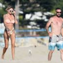 Tina Louise in a bikini with Brian Austin Green at the beach in Los Angeles - 454 x 341