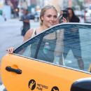 Actress AnnaSophia Robb is all smiles while enjoying some solo shopping in New York City, New York on July 14, 2015