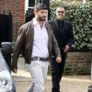George Michael and partner Fadi Fawaz are seen leaving there home - 396 x 594