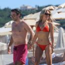 Sylvie Meis in Red Bikini on a beach in Saint Tropez