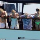 Queen's Roger Taylor uses a pole and shoots an AIRGUN at jellyfish whilst on a boat ride with his wife and children during sun-soaked holiday in Spain, 31 May 2019 - 454 x 290