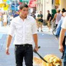 Nick Jonas grabs a bite to eat at an outdoor cafe and takes his dog for a walk in NYC