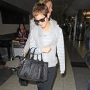 Emma Watson - Leaves her hotel and arrives at La Guadia Airport in New York City - November 16, 2010