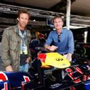 Actor Aaron Eckhardt and former F1 driver David Coulthard are seen in the Red Bull Racing garage before the Australian Formula One Grand Prix at the Albert Park circuit on March 18, 2012 in Melbourne, Australia