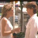 Left: Sharon Stone as May Munro/Adrian Hastings; Right: Eric Roberts as Tomas Leon.
