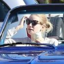 Nick Young and his rapper girlfriend Iggy Azelea ride in style to grab some Chick-fil-A in Los Angeles California on December 23, 2014 - 454 x 311