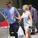 Jennie Garth and husband Dave Abrams g out shopping at Macy's in Los Angeles, California on August 26, 2016 - 454 x 593