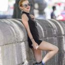 Bella Thorne in Black Mini Dress out in Montreal - 454 x 681