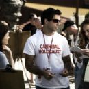 Writer-Director Eli Roth (center) with Lauren German (left) and Bijou Phillips (right) on the set of his film HOSTEL PART II. Photo credit: Rico Torres / Lionsgate
