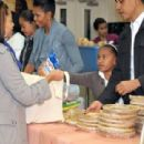Obama Family Distributes Food At Martha's Table