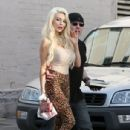 Courtney Coyly Waves to the Paps