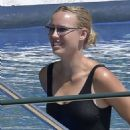 Caroline Wozniacki – In black swimsuit poolside in Portofino - 454 x 541