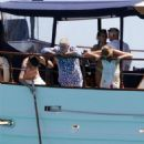 Queen's Roger Taylor uses a pole and shoots an AIRGUN at jellyfish whilst on a boat ride with his wife and children during sun-soaked holiday in Spain, 31 May 2019 - 454 x 681