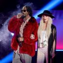 Rapper Snoop Dogg and singer Ke$ha speak onstage during the 2013 MTV Movie Awards at Sony Pictures Studios on April 14, 2013 in Culver City, California