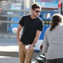 Zac Efron stops to fill up his gas tank in Studio City, CA on November 16th, 2012
