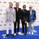 Simon Le Bon, John Taylor, Roger Taylor and Nick Rhodes of Duran Duran attend the Nordoff Robbins 02 Silver clef Awards at The Grosvenor House Hotel on July 3, 2015 in London, England. - 454 x 294