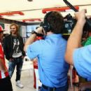 DJ and producer David Guetta meets driver Fernando Alonso as he visits the Ferrari garage at the Valencia Street Circuit before headlining the F1 Rocks in Valencia event held at the Agora on July 24, 2011, in Valencia, Spain