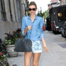 Miranda Kerr smiles for the camera while out and about in New York City June 17th,2013