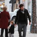 Orlando Bloom does some Christmas shopping with his son Flynn in Beverly Hills, California on December 22, 2012