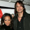 Robin Givens and Marcus Schenkenberg
