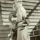 Claire Trevor and Randolph Scott