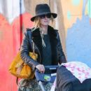 Nicky Hilton is spotted pushing her daughter Lily Grace in a stroller in New York City, New York on October 14, 2016