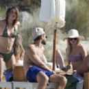 Bambi Northwood Blyth in Tiny Bikini on the beach in Ibiza - 454 x 303