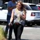 Singer and actress Hilary Duff is all smiles while stopping by Starbucks in Culver City, California on September 6, 2013