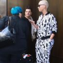 Amber Rose and Tara Reid were spotted posing for fans as they stepped out of their hotel in New York, New York - April 6, 2012 - 414 x 594