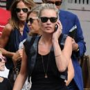 Kate Moss visiting the Flask pub in Highgate, London with her daughter today (August 11)