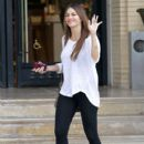 Sofia Vergara smiles for photographers as she leaves a department store in Los Angeles