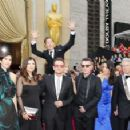 Actor Benedict Cumberbatch jumps behind U2 at the 86th Academy Awards in Hollywood (2014)