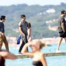 Zac Efron boards a boat with some friends while vacationing in Saint-Tropez, France on July 4, 2012