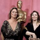 Louise Fletcher and Faye Dunaway during The 49th Annual Academy Awards (1977)