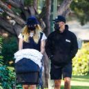 Sophie Turner and Joe Jonas – Out for a walk with their new baby Willa in Los Angeles